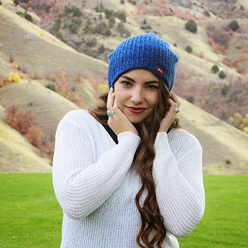 blue beanie white sweater