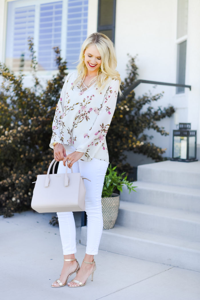 floral top and white jeans