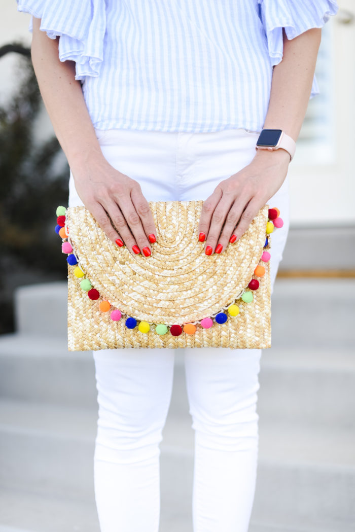 straw clutch with pom poms