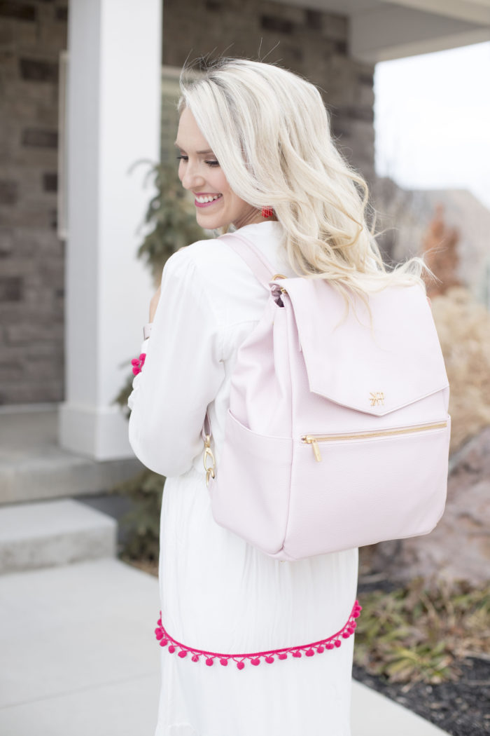Freshly Picked discount code featured by top Utah life and style blog, A Slice of Style: image of a woman holding a pink Freshly Picked diaper bag
