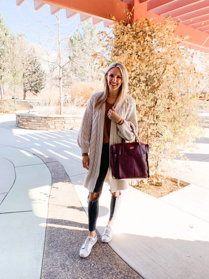 Best Labor Day Sales 2019 by popular Utah fashion blog: image of a woman standing outside and holding the birch Freshly Picked leather bag.