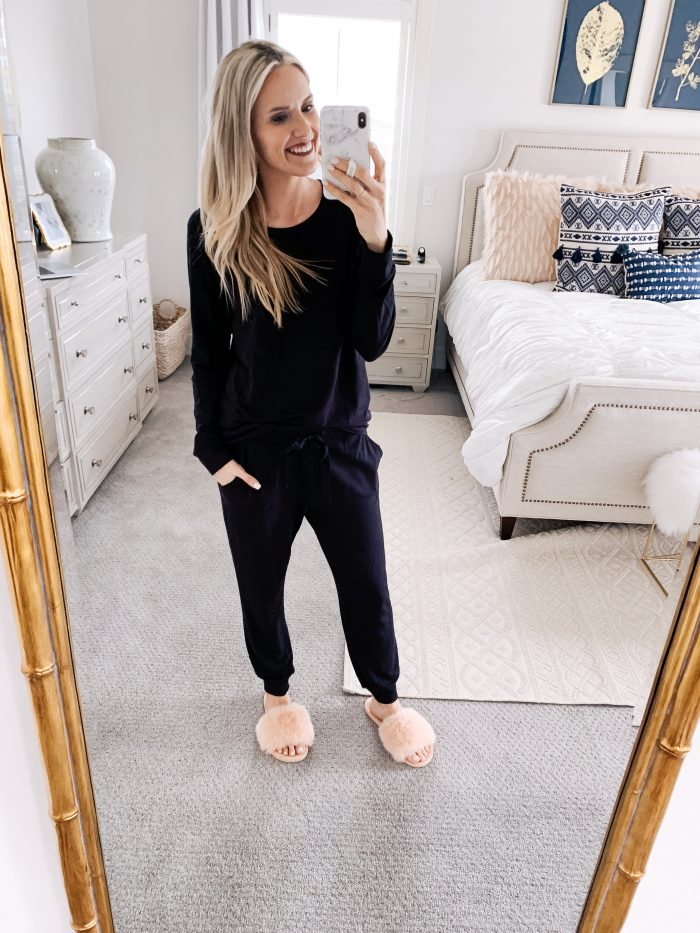 Amazon Joggers featured by top US fashion blog A Slice of Style; Image of a woman wearing Amazon sweatshirt, Amazon joggers and Amazon slippers.