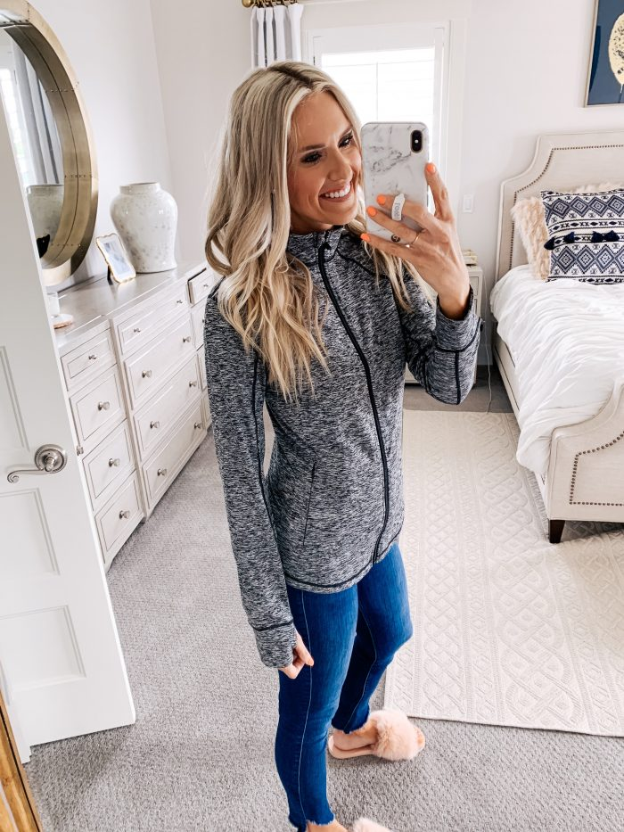 Lululemon dupes found on Amazon featured by top US life and style blog, A Slice of Style: image of a woman wearing CRZ YOGA leggings, CRZ YOGA bra, and Amazon Essentials full zip jacket.