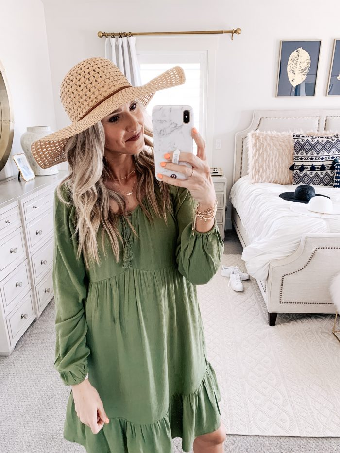 Affordable Walmart fashion favorites featured by top US fashion blog, A Slice of Style: image of a woman wearing a Time and Tru olive midi dress and a sunhat available at Walmart