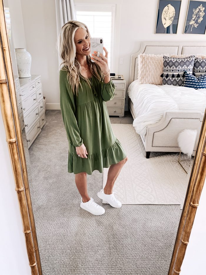 Affordable Walmart fashion favorites featured by top US fashion blog, A Slice of Style: image of a woman wearing a Time and Tru olive midi dress and white sneakers available at Walmart