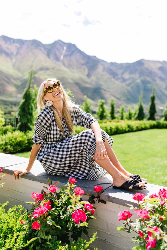 J Crew Summer Style featured by top US life and style blog, A Slice of Style: image of a woman wearing a J crew gingham button up dress, J crew leather sandals, J Crew raffia statement earrings, J Crew straw hat and J Crew oversized sunglasses