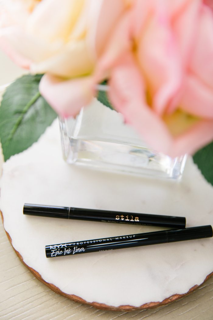 Affordable Amazon Beauty Dupes + Latest Amazon Favorites! by popular Utah beauty blog, A Slice of Style: image of Stilla and NYX black in eyeliner next to a small vase of roses.