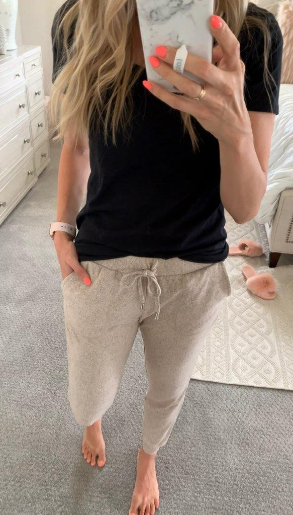 Best of Amazon Prime Day: $7.50 Earrings You Need! by popular Utah fashion blog, A Slice of Style: image of a woman taking a selfie in front of full body mirror and wearing a black v-neck tee and find. Women's Tracksuit Bottoms in Super Soft for Jogging.