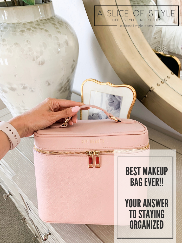 The Only Makeup Bag I'll Ever Need Again!! Sly Beauty Discount Code by popular Utah beauty blog, A Slice of Style: image of a woman's hand holding a pink Sly Beauty Bag.