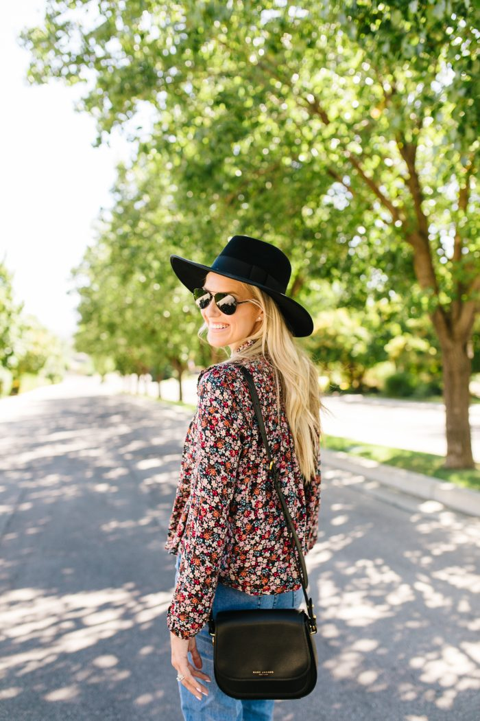 Summer to Fall Transition Pieces from Nordstrom featured by top US life and style blog, A Slice of Style: image of a woman wearing a Rebecca Minkoff crossbody bag, One Print floral blouse, Rachel Parcell girlfriend jeans, Caslon sandals, Polaroid Eyewear aviator sunglasses, and a Brixton felt hat.