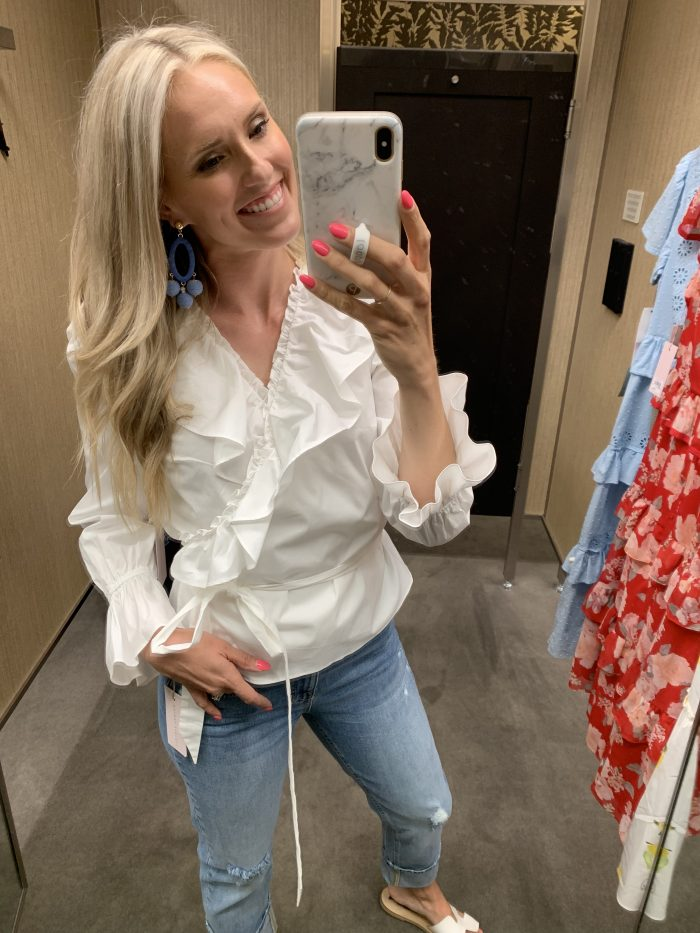 Best Labor Day Sales 2019 by popular Utah fashion blog: image of a woman standing in a dressing room and wearing a Nordstrom Rachel Parcell Ruffle Wrap Top.