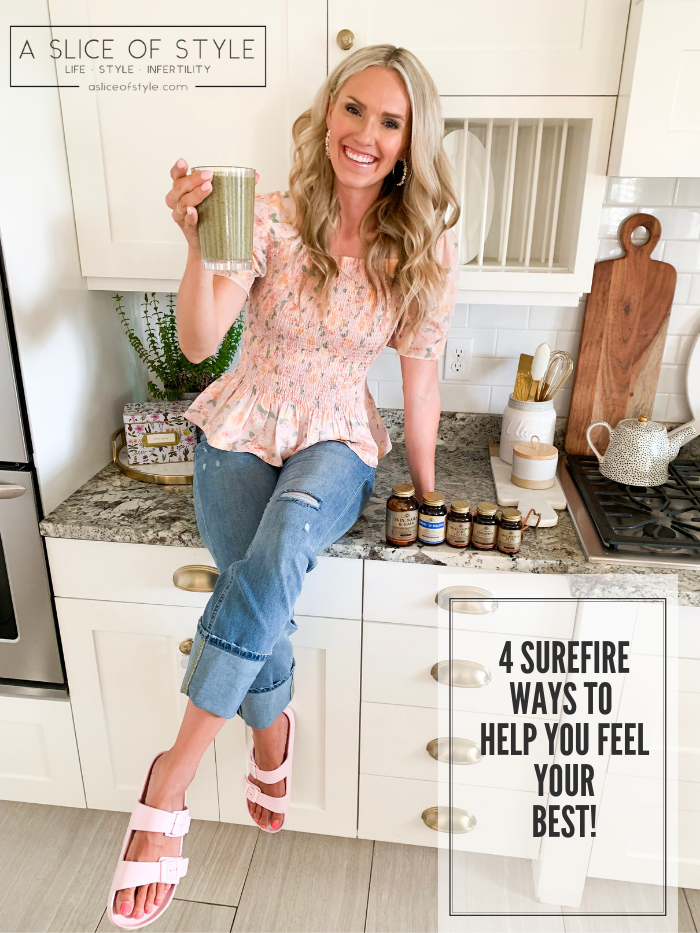 Solgar Vitamins Review + Green Smoothie Recipe by popular Utah life and style blog, A Slice of Style: image of a woman sitting on her kitchen counter next to various bottle of Solgar vitamins and holding a green smoothie in a clear tumbler cup.