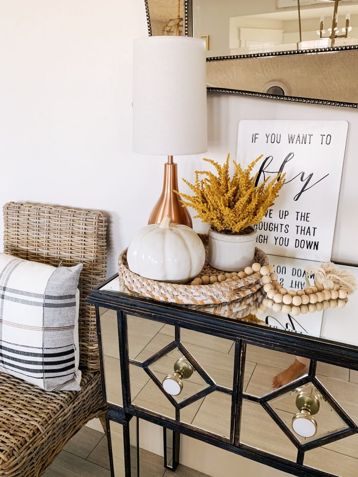 "My Home Decorated for Fall! by popular Utah lifestyle blog, A Slice of Style: image of a entry table decorated with white Home Depot Three Hands ceramic vases and a Threshold 11"" x 10"" Artificial Goldenrod Arrangement in Ceramic Pot from Target."