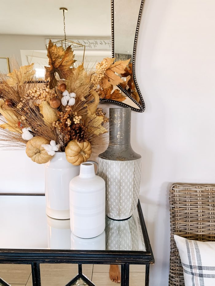 My Home Decorated for Fall! by popular Utah lifestyle blog, A Slice of Style: image of a entry table decorated with white Home Depot Three Hands ceramic vases.