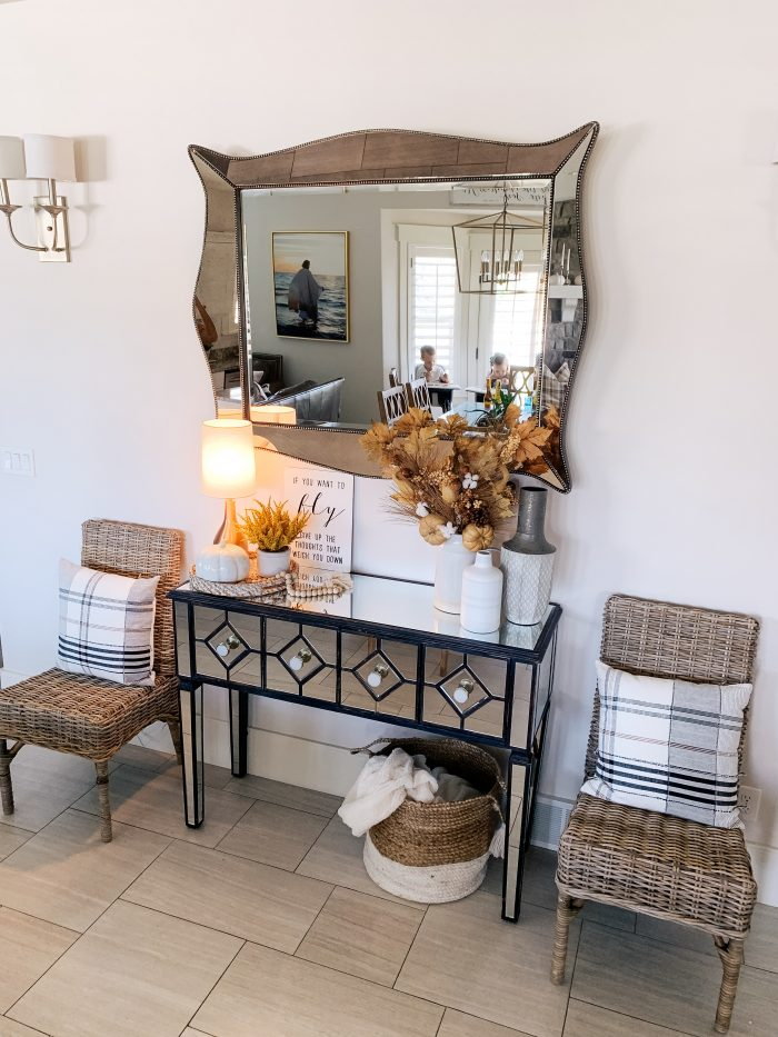 """My Home Decorated for Fall! by popular Utah lifestyle blog, A Slice of Style: image of a entry table decorated with white Home Depot Three Hands ceramic vases, a Threshold 11"""" x 10"""" Artificial Goldenrod Arrangement in Ceramic Pot from Target and a Home Depot LR Resources Natural Jute Decorative Storage Basket underneath with some neutral blankets in it."""