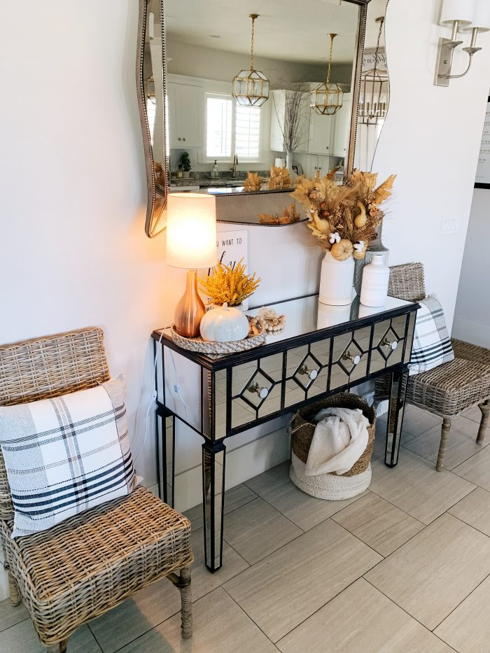 """My Home Decorated for Fall! by popular Utah lifestyle blog, A Slice of Style: image of a entry table decorated with white Home Depot Three Hands ceramic vases and a Threshold 11"""" x 10"""" Artificial Goldenrod Arrangement in Ceramic Pot from Target."""