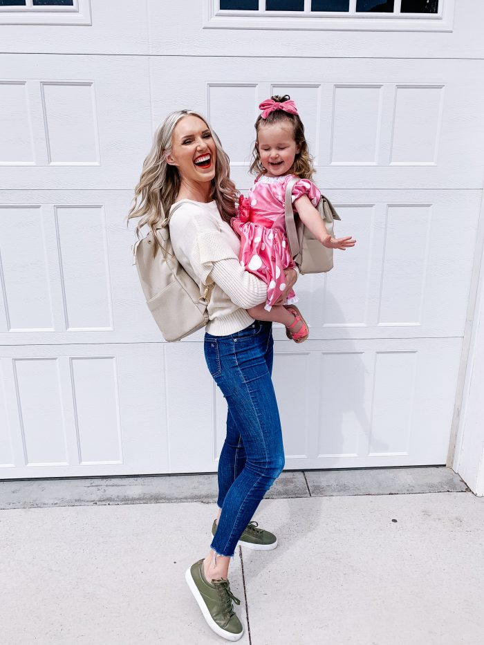 Freshly Picked Coupon Code! by popular Utah fashion blog, A Slice of Style: image of a woman holding her daughter and wearing a Freshly Picked Diaper bag back pack.