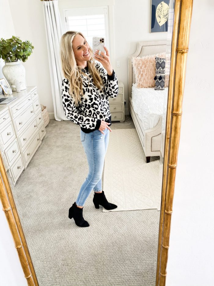 Walmart Fall fashion haul featured by top US fashion blog, A Slice of Style: image of a woman wearing a cheetah print sweater from Walmart