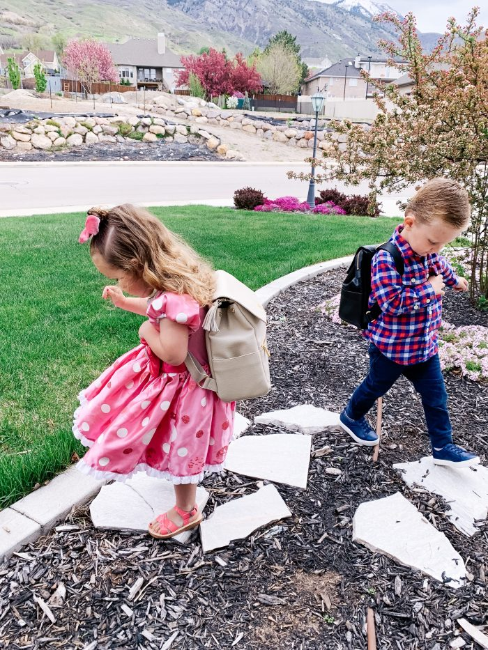 Freshly Picked Coupon Code! by popular Utah fashion blog, A Slice of Style: image of a boy and girl outside wearing Freshly Picked Sandals, Freshly Picked sneakers, and Freshly Picked backpacks.