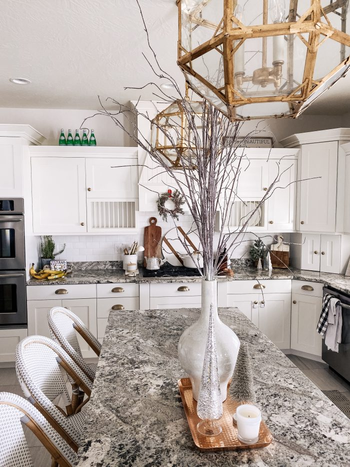 White Christmas decor featured by top US life and style blog, A Slice of Style | My White Christmas Home Decor: Some Items Under $10! by popular Utah lifestyle blog, A Slice of Style: image of a kitchen decorated with white Christmas home decor items.