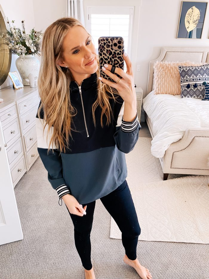 Walmart Fashion January Haul! by popular Utah mom style blog, A Slice of Style: image of a woman wearing a Wallmart Avia Women's Athleisure 1/4 Zip Colorblock Pullover Hoodie.