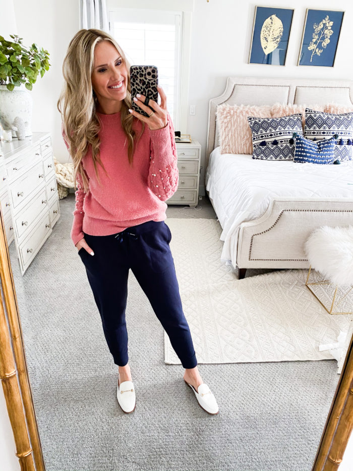 Best Loungewear on Amazon by popular Utah fashion blog, A Slice of Style: image of a woman wearing a pink sweater with pearl accented sleeves, white loafer slides and blue joggers.