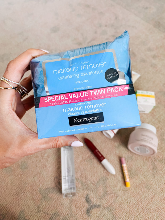 Walmart Beauty Products by popular Utah beauty blog, A Slice of Style: image of a woman holding a package of Walmart Neutrogena makeup remover cleansing towelettes.