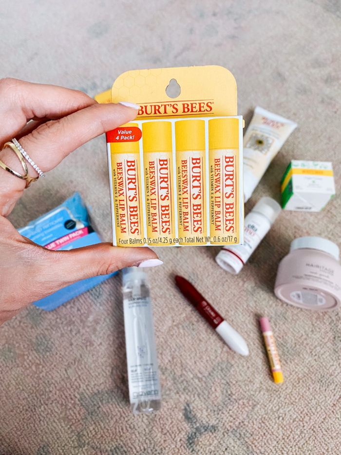 Walmart Beauty Products by popular Utah beauty blog, A Slice of Style: image of a woman holding a Walmart Burt's Bees Beeswax Lip Balm 4 pack.