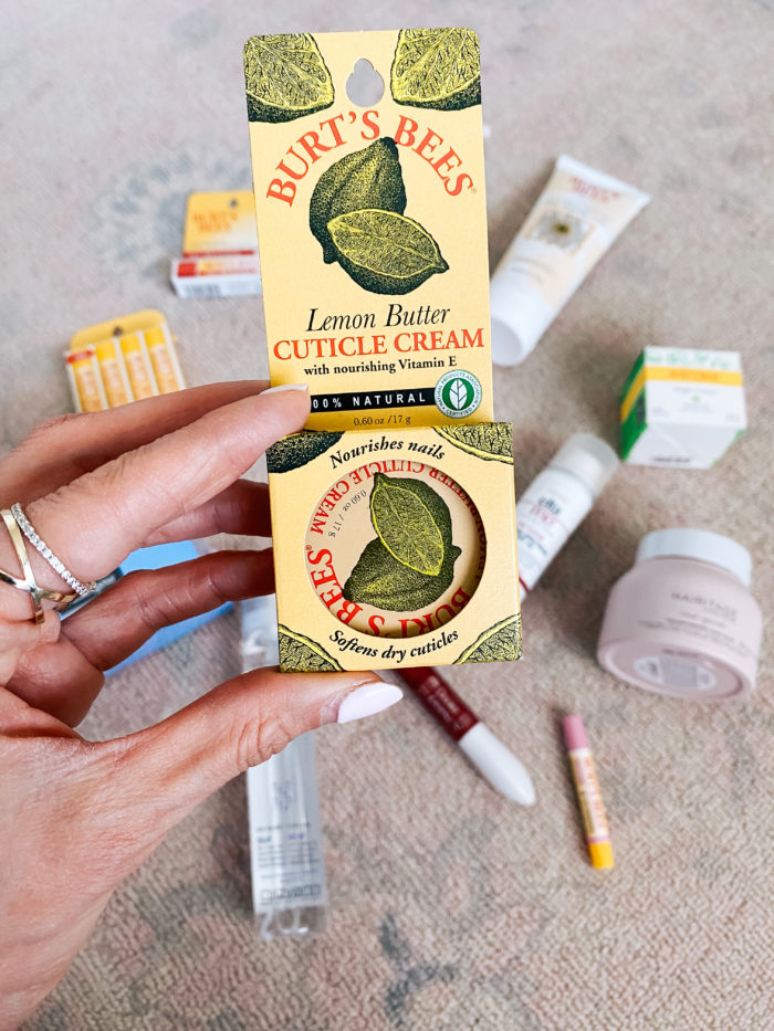 Walmart Beauty Products by popular Utah beauty blog, A Slice of Style: image of a woman holding a Walmart Burt's Bees cuticle cream.
