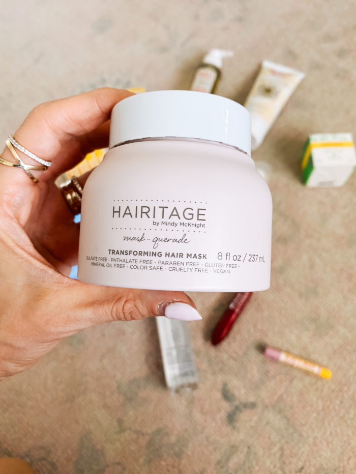 Walmart Beauty Products by popular Utah beauty blog, A Slice of Style: image of a woman holding a jar of Walmart Hairitage mask-querade hair mask.