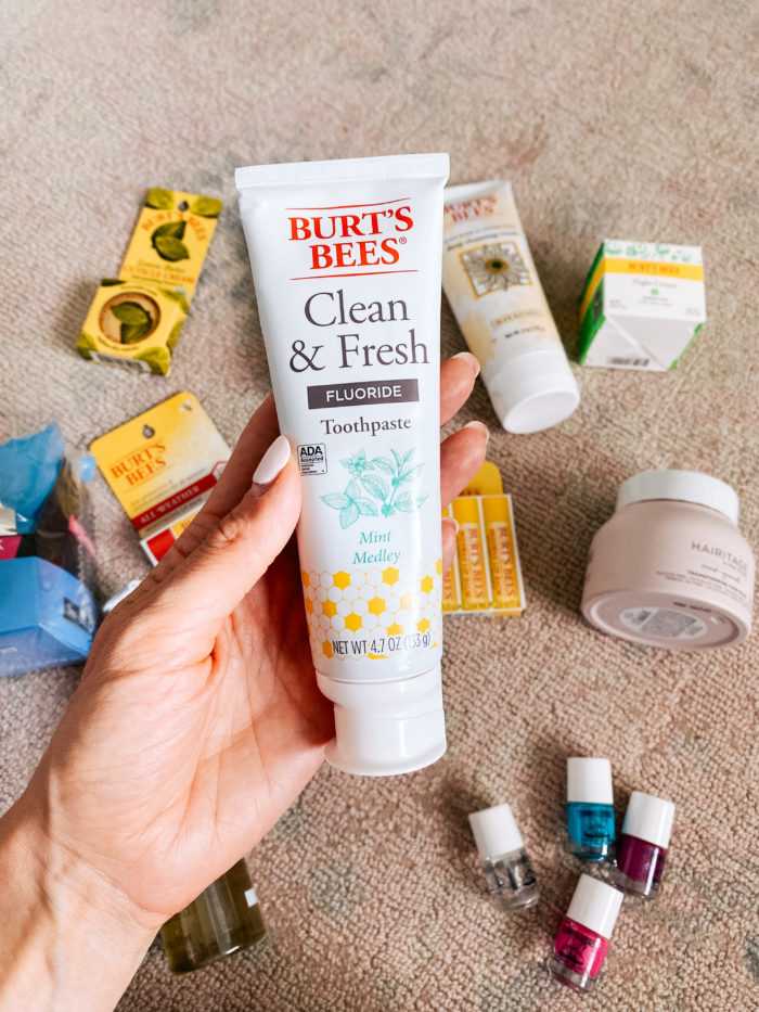 Walmart Beauty Products by popular Utah beauty blog, A Slice of Style: image of a woman holding a tube of Walmart Burt's Bees clean and fresh toothpaste.