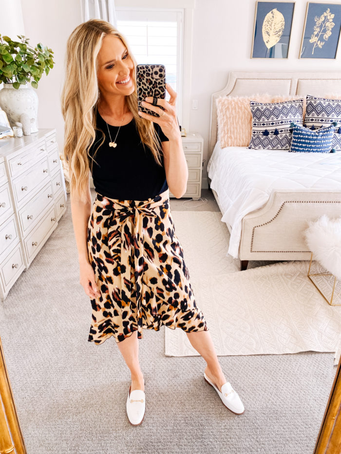 Amazon haul by popular Utah fashion blog, A Slice of Style: image of a woman wearing a Amazon IEFSHINY Heart Initial Necklace for Women, Amazon SheIn Women's Leopard Print Ruffle Hem Casual Midi Wrap Skirt and Amazon Sam Edelman Women's Linnie Mule.