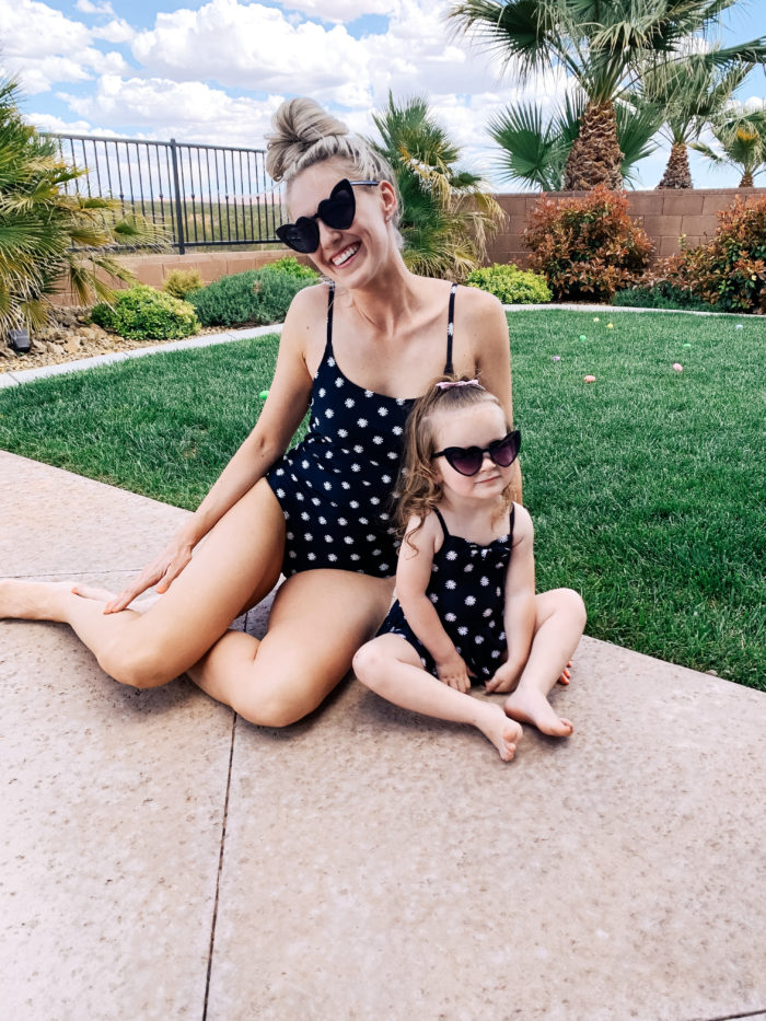 Easter Essentials by popular Utah lifestyle blog, A Slice of Style: image of a mom and daughter wearing matching swimsuits and heart shaped sunglasses.