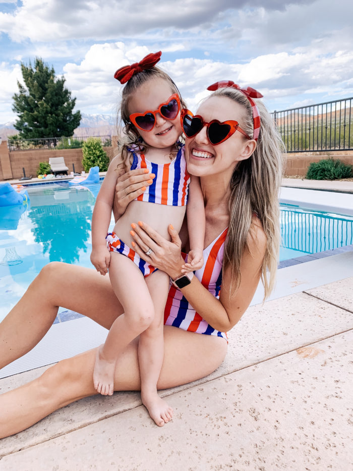 Easter Essentials by popular Utah lifestyle blog, A Slice of Style: image of a mom and daughter in matching swimsuits and heart shaped sunglasses.