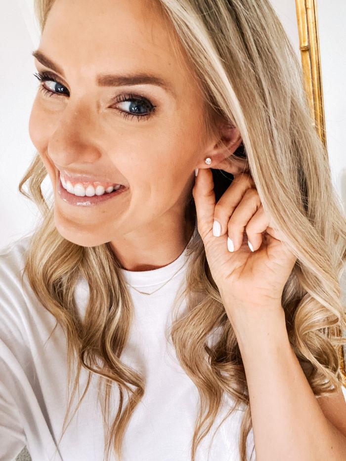 Amazon Fashion Haul by popular Utah fashion blog, A Slice of Style: image of a woman wearing a Amazon Daily Ritual Women's Jersey Short-Sleeve Crewneck Boxy Pocket T-Shirt and Amazon Raneecoco CZ stud earrings.
