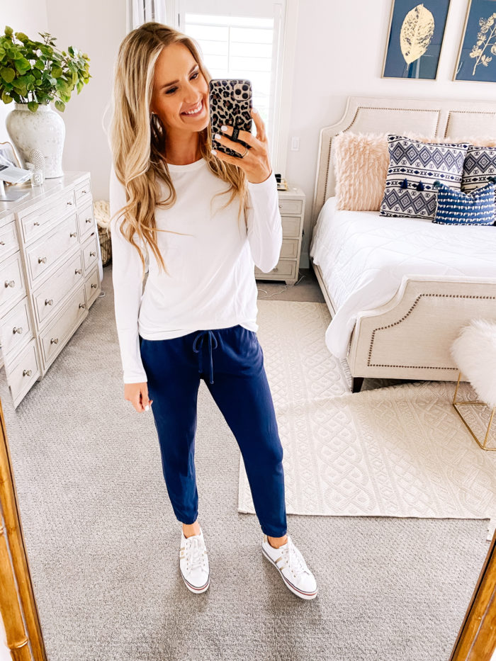 Amazon fashion haul for women | Amazon Fashion Haul by popular Utah fashion blog, A Slice of Style: image of a woman wearing a Amazon Essentials Women's Classic-Fit Long-Sleeve Crewneck T-Shirt, blue joggers, and Amazon Tommy Hilfiger Fentii sneakers.