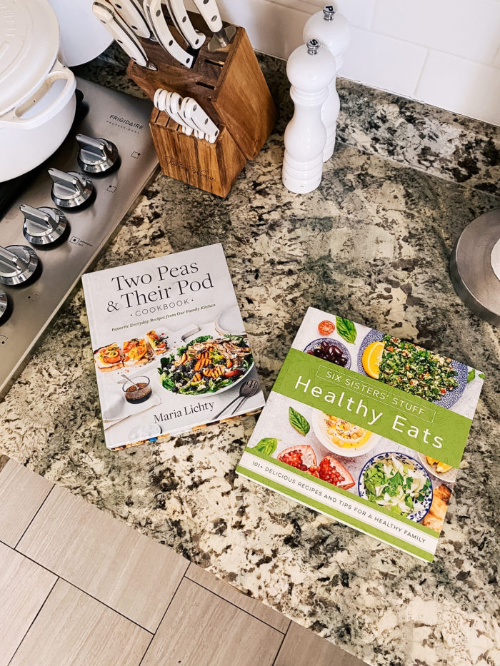 Best Kitchen Tools by popular Utah lifestyle blog, A Slice of Style: image of Two Peas & Their Pod cookbook and Six Sisters Stuff Healthy Eats cookbook on a granite countertop.