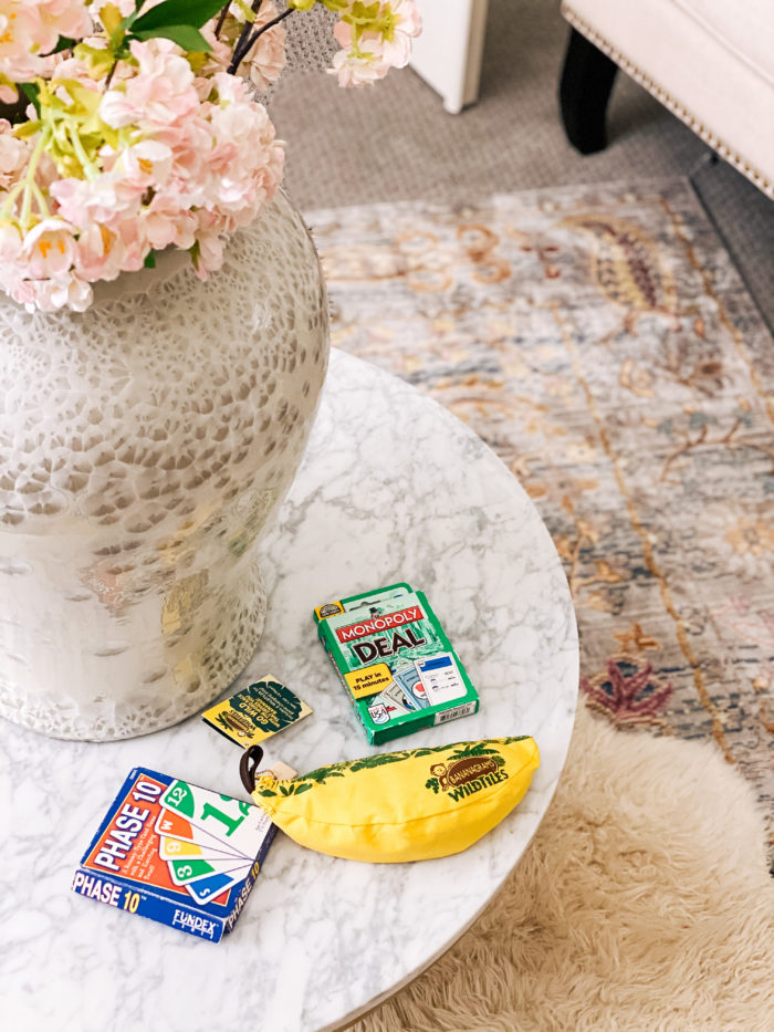 2-player games |  2 Player Games by popular Utah lifestyle blog, A Slice of Style: Pinterest image of Phase 10, Monopoly Deal, and Bananagram wild tiles on a marble coffee table.