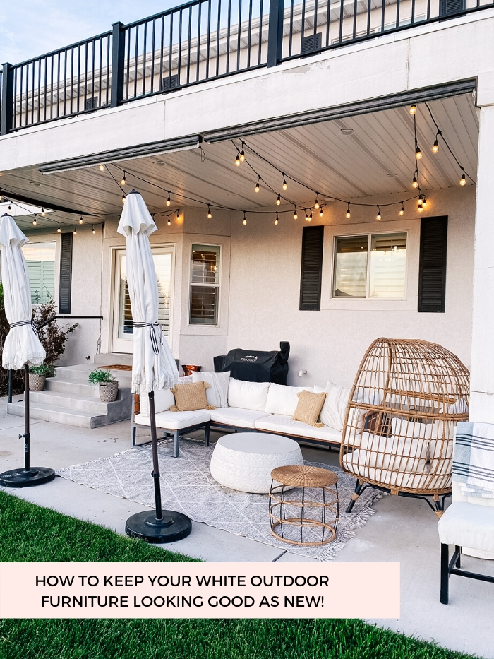 White Outdoor Cushions by popular Utah life and style blog, A Slice of Style: image of a backyard patio with bistro lights, white shade umbrellas, patio furniture and white outdoor cushions.