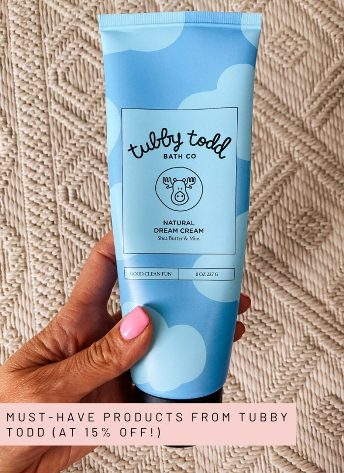 Tubby Todd Discount Code by popular Utah motherhood blog, A Slice of Style: image of a woman holding a bottle of Tubby Todd Natural Dream Cream.