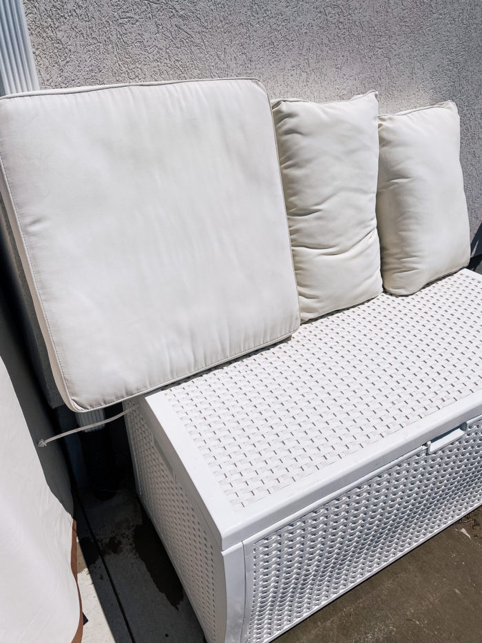 White Outdoor Cushions by popular Utah life and style blog, A Slice of Style: image of a white outdoor storage box.