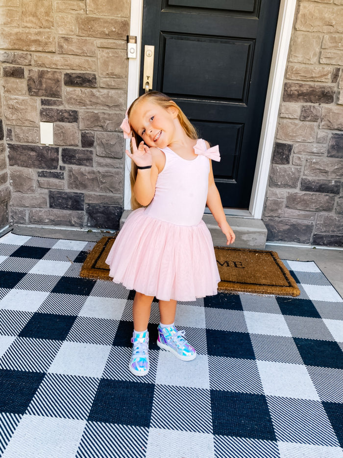 Back to School Fashion with Walmart featured by top Utah lifestyle blogger, A Slice of Style. | Walmart Back to School by popular Utah lifestyle blog, A Slice of Style: image of a little girl wearing a pair of Walmart Wonder Nation Athletic Iridescent High-Top Sneakers and a pink tutu.