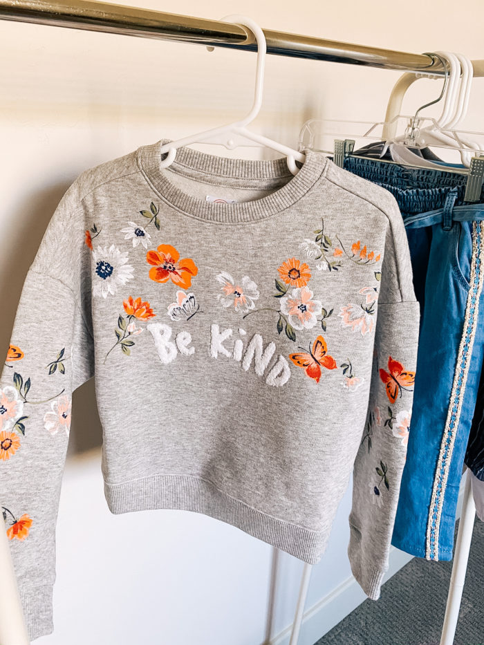 Back to School Fashion with Walmart featured by top Utah lifestyle blogger, A Slice of Style. | Walmart Back to School by popular Utah lifestyle blog, A Slice of Style: image of a Walmart Wonder Nation Girls Be Kind Floral Crewneck Pullover Sweatshirt.
