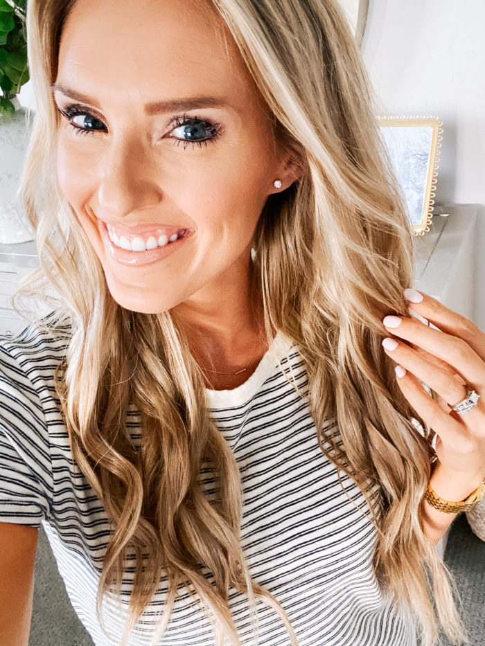 "Summer Essentials by popular Utah life and style blog, A Slice of Style: image of Jenica Parcell wearing a pair of Amazon ""STUNNING FLAME"" 18K Gold Plated Silver Brilliant Cut Simulated Diamond Cubic Zirconia Stud Earrings."