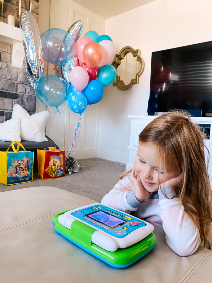 4th Birthday Party by popular Utah motherhood blog, A Slice of Style: image of a little girl playing with a Leap Frog electronic toy.