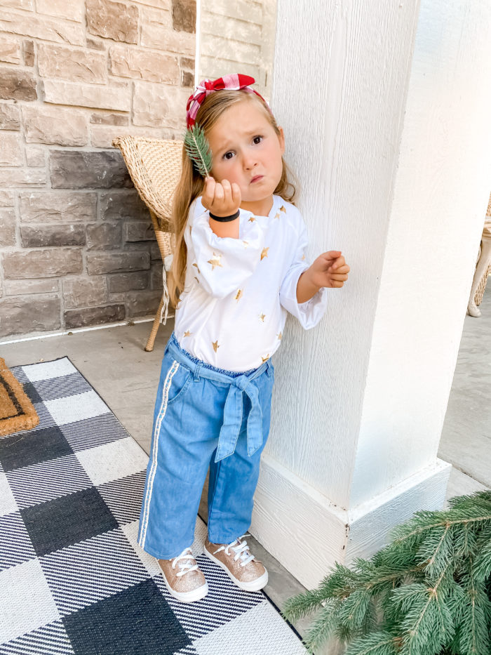 Back to School Fashion with Walmart featured by top Utah lifestyle blogger, A Slice of Style. | Walmart Back to School by popular Utah lifestyle blog, A Slice of Style: image of a little girl wearing a Walmart Wonder Nation Girls Long Sleeve Foil Tie-Front Top, Walmart Wonder Nation Baby Toddler Girl Belted Wide Leg Cropped Jeans, and Walmart Wonder Nation Casual Bump Toe Sneaker.