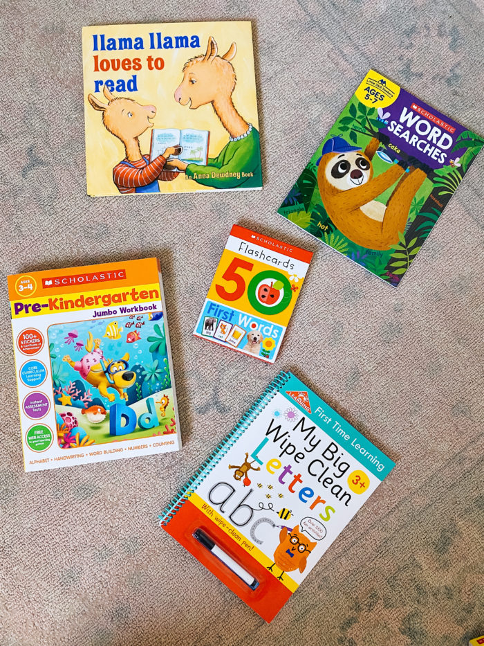 Walmart Back to School by popular Utah lifestyle blog, A Slice of Style: image of Walmart Scholastic Workbooks, flash cards, Scholastic word searches, and Llama Llama loves to read.