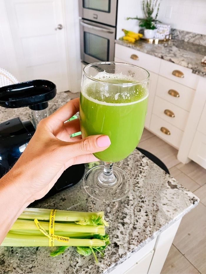 Epstein-Barr | Epstein-Barr Virus by popular Utah lifestyle blog, A Slice of Style: image of a woman holding a glass of celery juice.