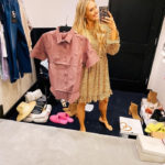 Nordstrom Anniversary Sale by popular Utah fashion blog, A Slice of Style: image of Jenica Parcell holding a TravisMathew red button up shirt.