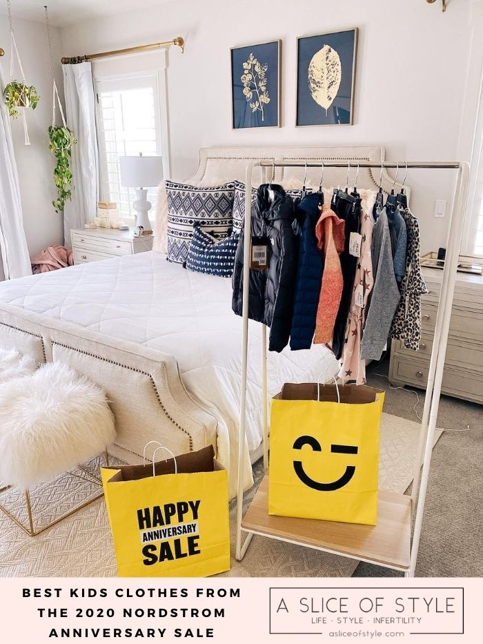 Nordstrom Anniversary Sale by popular Utah fashion blog, A Slice of Style : image of Nordstrom kids' clothes hanging on a clothing wrack that's next to some Nordstrom Anniversary Sale shopping bags.
